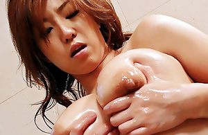 Gorgeous Japanese slut Naho lubes up her enticing body and then fingers her prudish muff