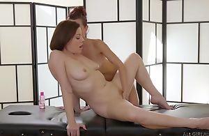 Two edacious lesbians licking passionately during a massage