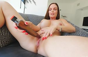 Frisky MILF with chunky honkers fucks herself with a huge toy