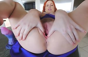 Stunning redhead chick with big naturals masturbates in be passed on kitchen