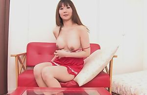 Oriental bombshell fucks herself with double-sized sex toy
