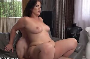 Slightly chubby MILF less incompetent boobs copulates young chum