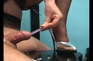Mistress inserting toothrbush all round a guy'_s cock while she jerks with an increment of makes him cum
