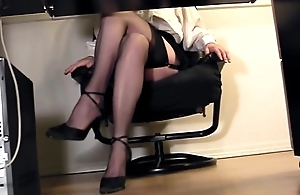 Leggy secretary subordinate to desk voyeur cam masturbation